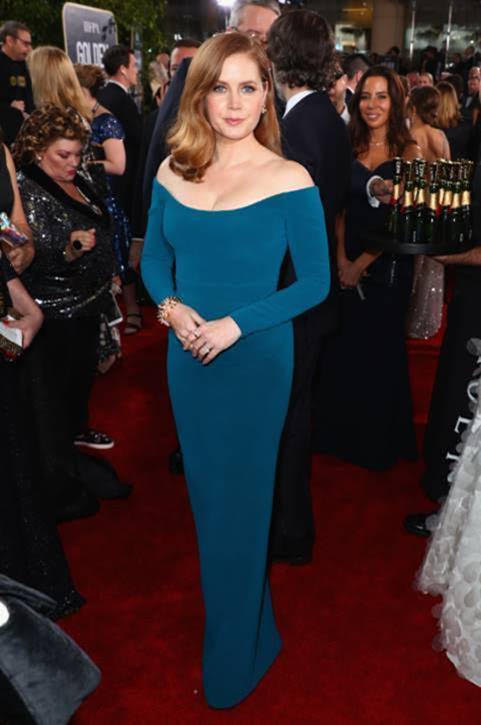 Amy Adams 'Toasts for a Cause' with Moët & Chandon Impérial minis at the 76th Annual Golden Globe Awards. Photo Credit: Michael Kovac & Joe Scarnici/Getty Images for Moët & Chandon]