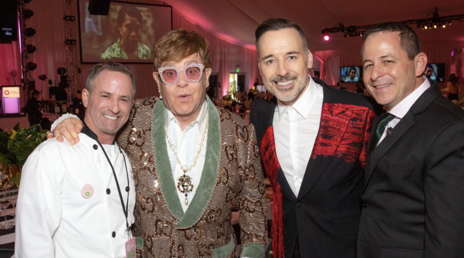 Chef Wayne Elias (left) and his business partner Chris Diamond (right) join Sir Elton John and husband David Furnish Photo Courtesy of Brian To/ Crumble Catering