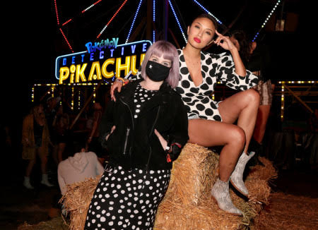 "Kelly Osbourne (L) and Jeannie Mai attend The Neon Carnival with ""POKÉMON Detective Pikachu"" and The LG Mobile Experience on April 27, 2019 in Thermal, California.  (Photo by Jerritt Clark