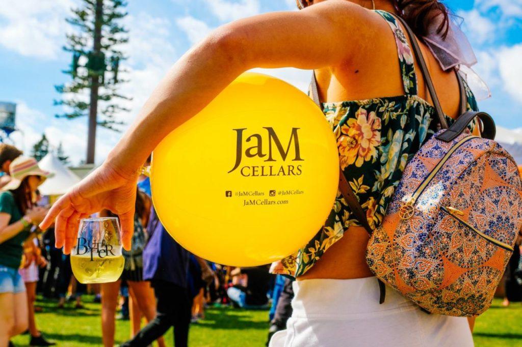 BottleRock attendee with Jam Cellars balloon and wine. (Courtesy of BottleRock/Sonoma Magazine)
