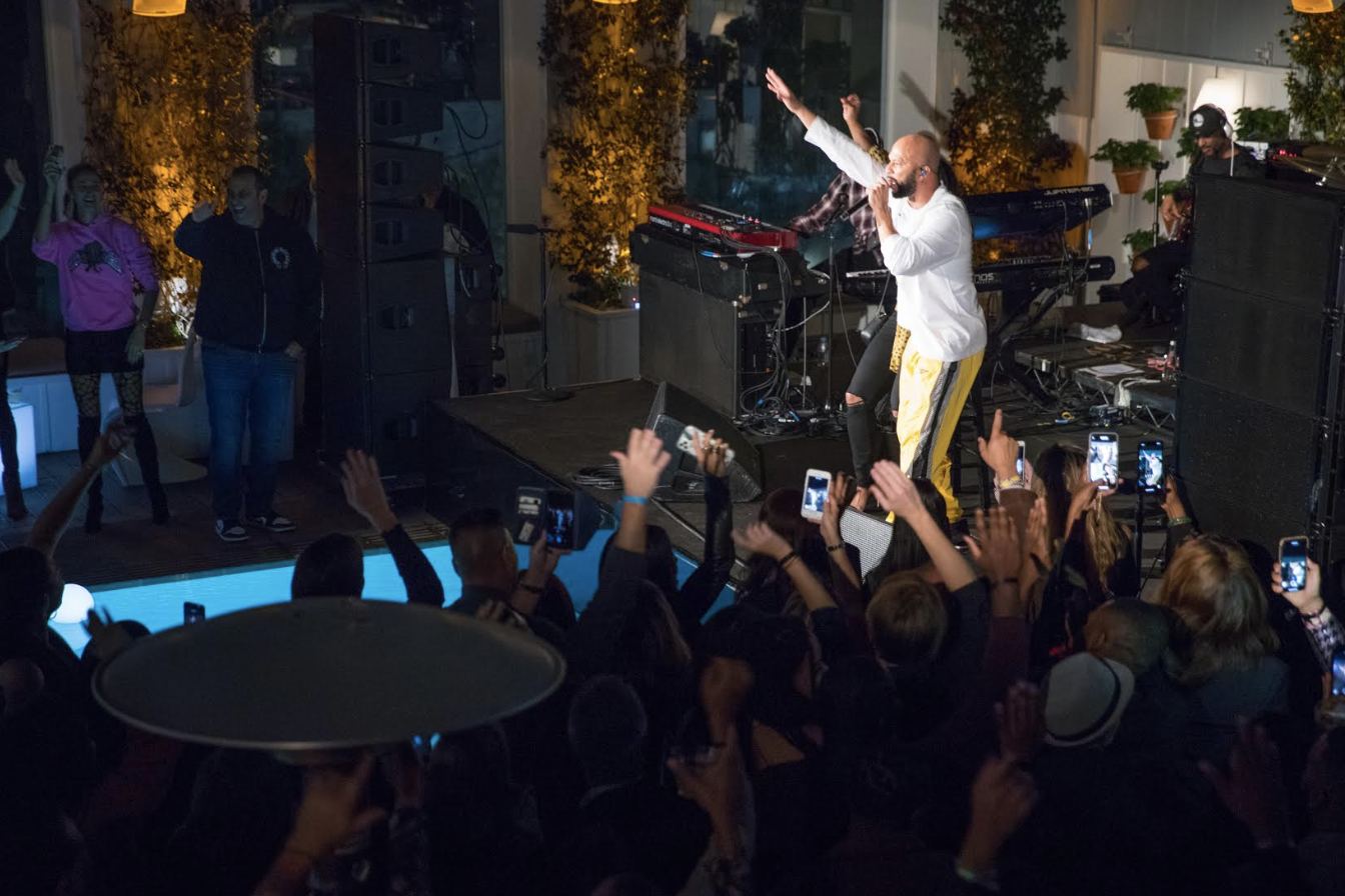 Common performs at the third annual Taste of sbe held at Skybar at Mondrian LA presented by Tidal, with Chase Sapphire®, and Sprint featuring restaurant delights from Cleo, Katsuya, Umami, Fi'lia, Carna, Leynia and Diez y Seis. Photo Credit: Courtesy of sbe/Ali Buck.