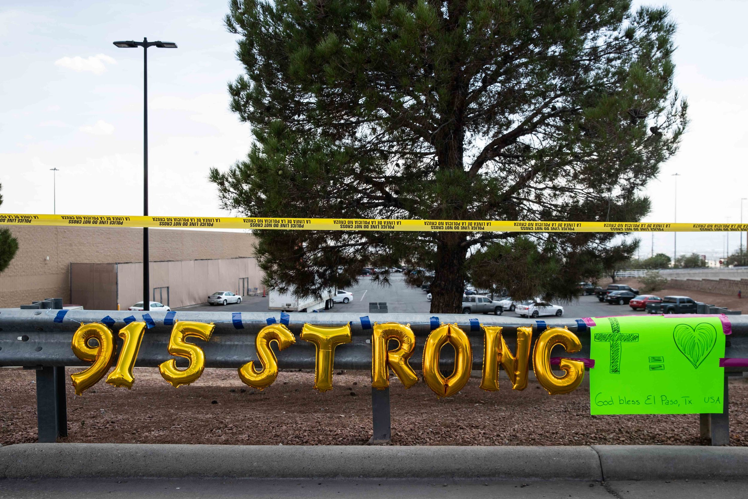 "El Paso area code 915 and the word ""strong"" spelled with golden balloons are placed on the scene where a mass shooting occurred in Walmart last Saturday morning to honor their memory in El Paso on Monday, August 5, 2019."