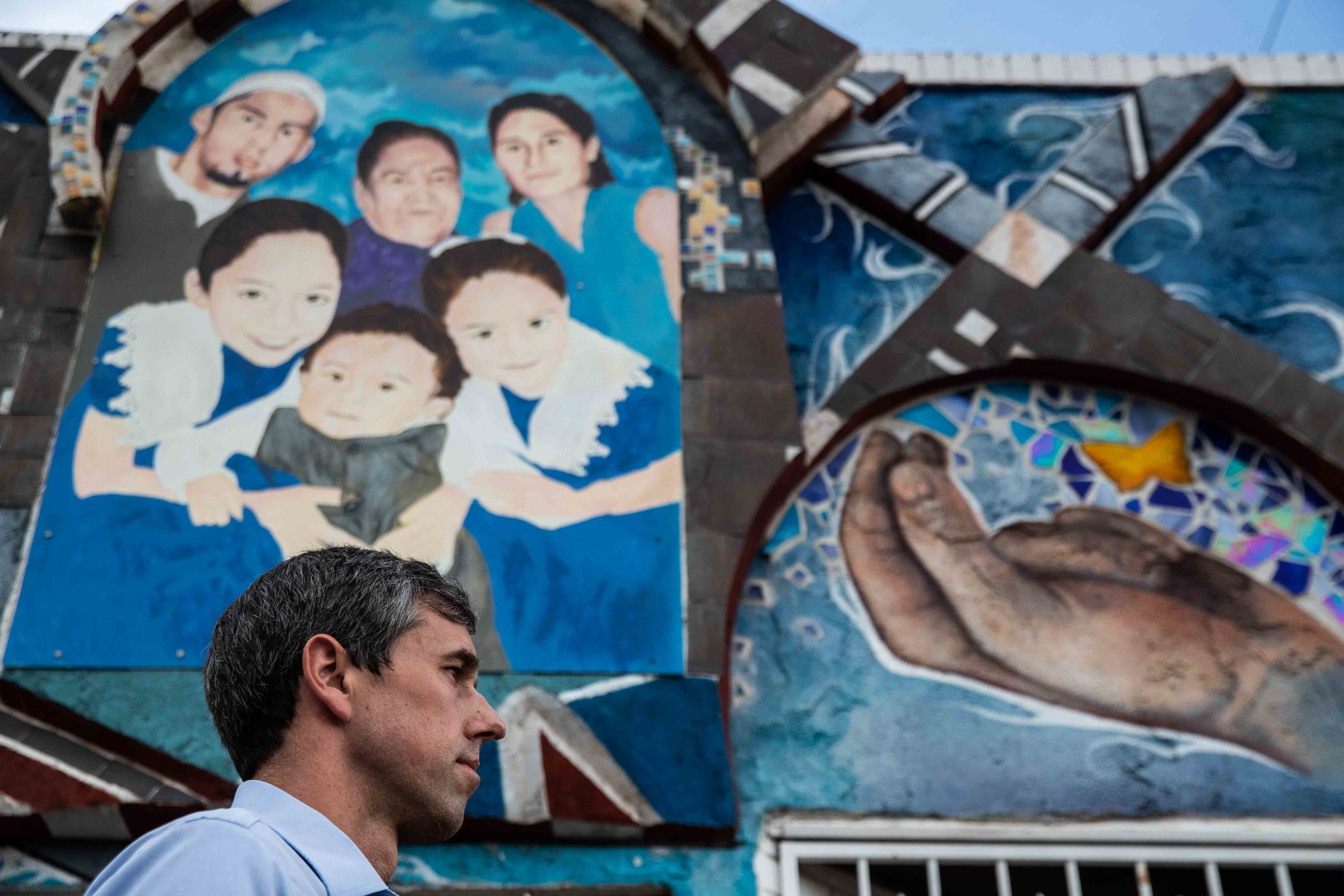 Democratic presidential candidate Beto O'Rourke walks in front of a mural at Yandell Dr. during a silent march in honor to the victims of a mass shooting occurred in Walmart on Satuday morning in El Paso on Sunday, August 4, 2019.