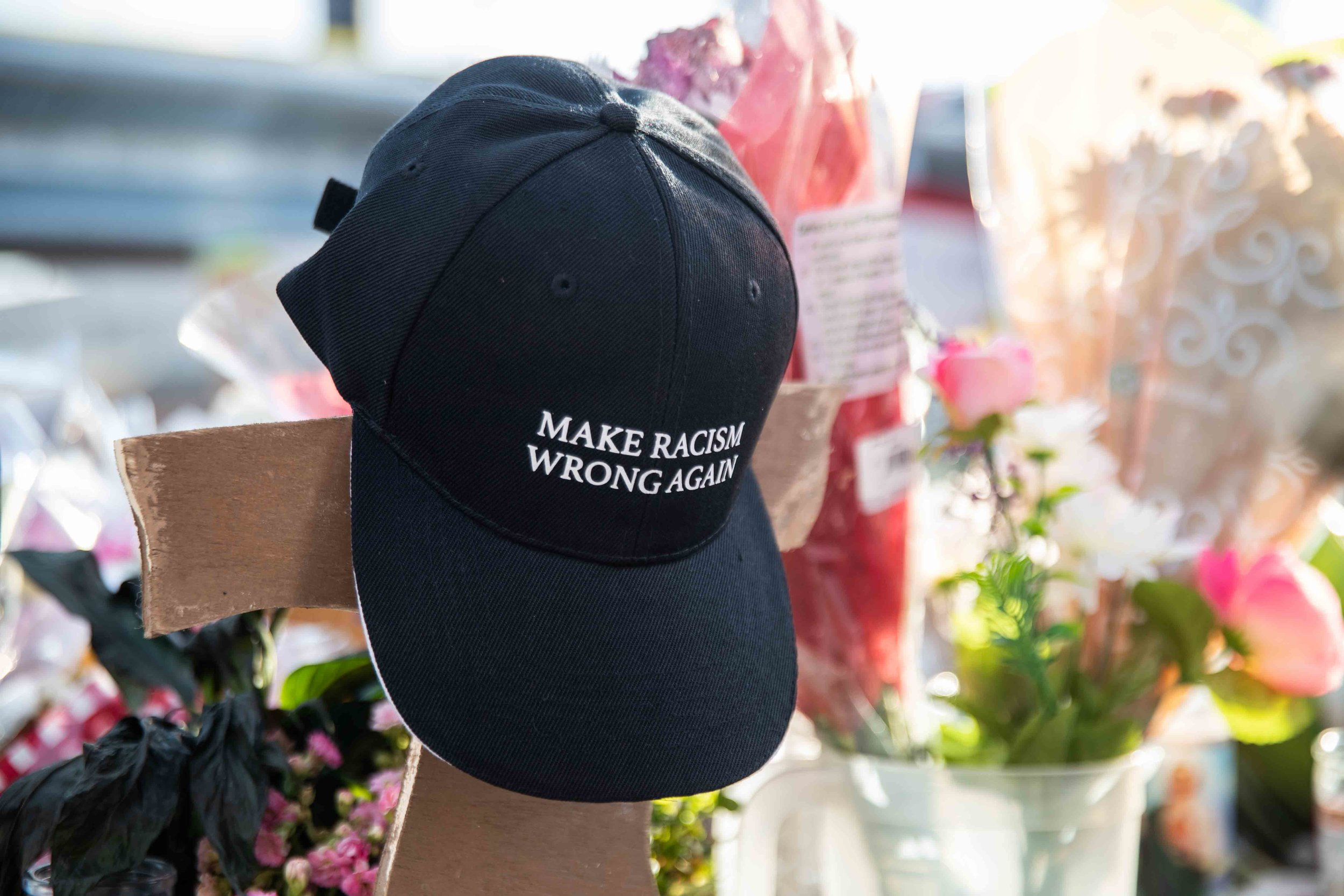 "A cap with ""MAKE RACISM WRONG AGAIN"" is placed at the scene where a mass shooting occurred in Walmart last Saturday morning to honor victims' memory in El Paso on Monday, August 5, 2019."
