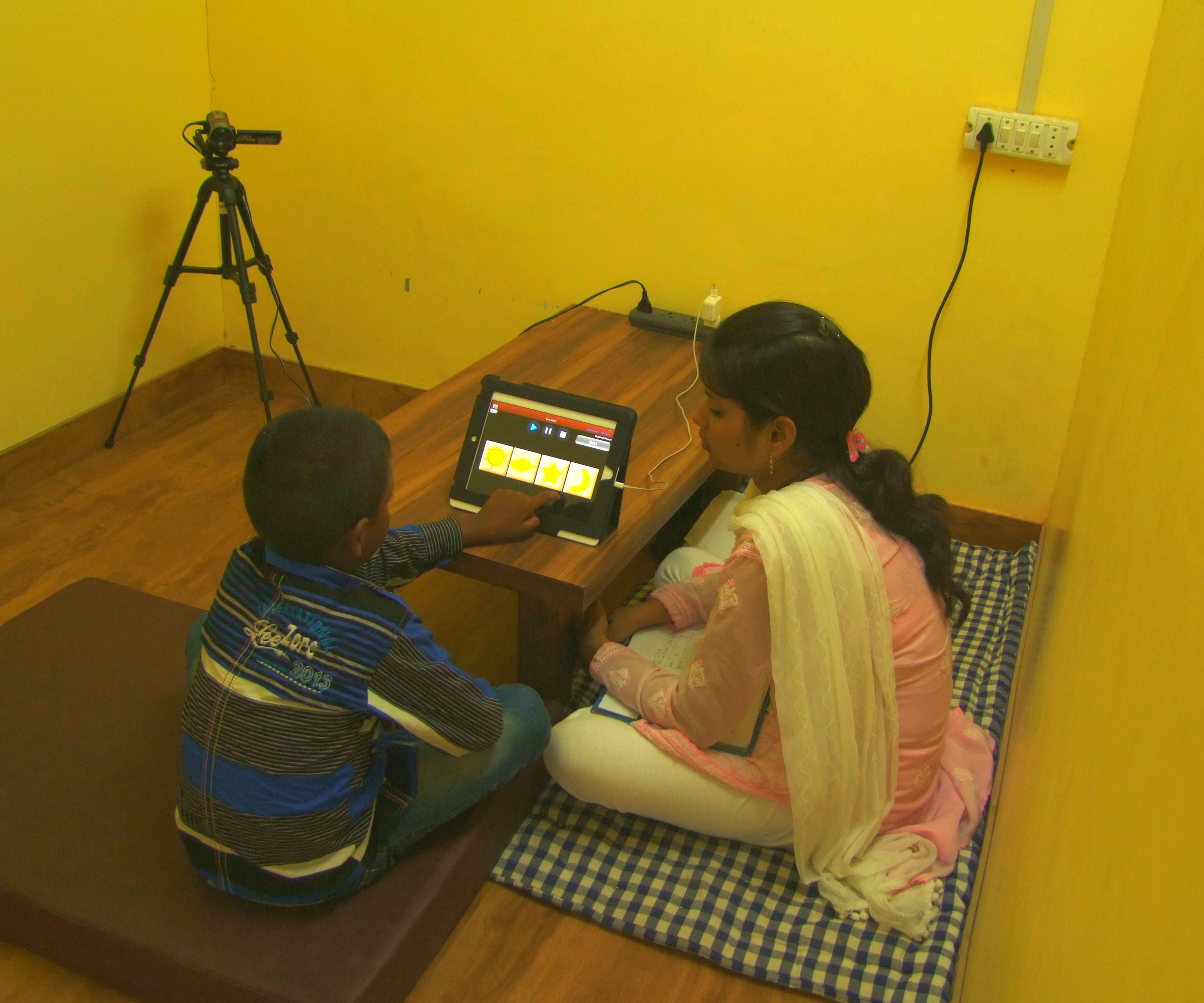 A child playing the interactive assessment games
