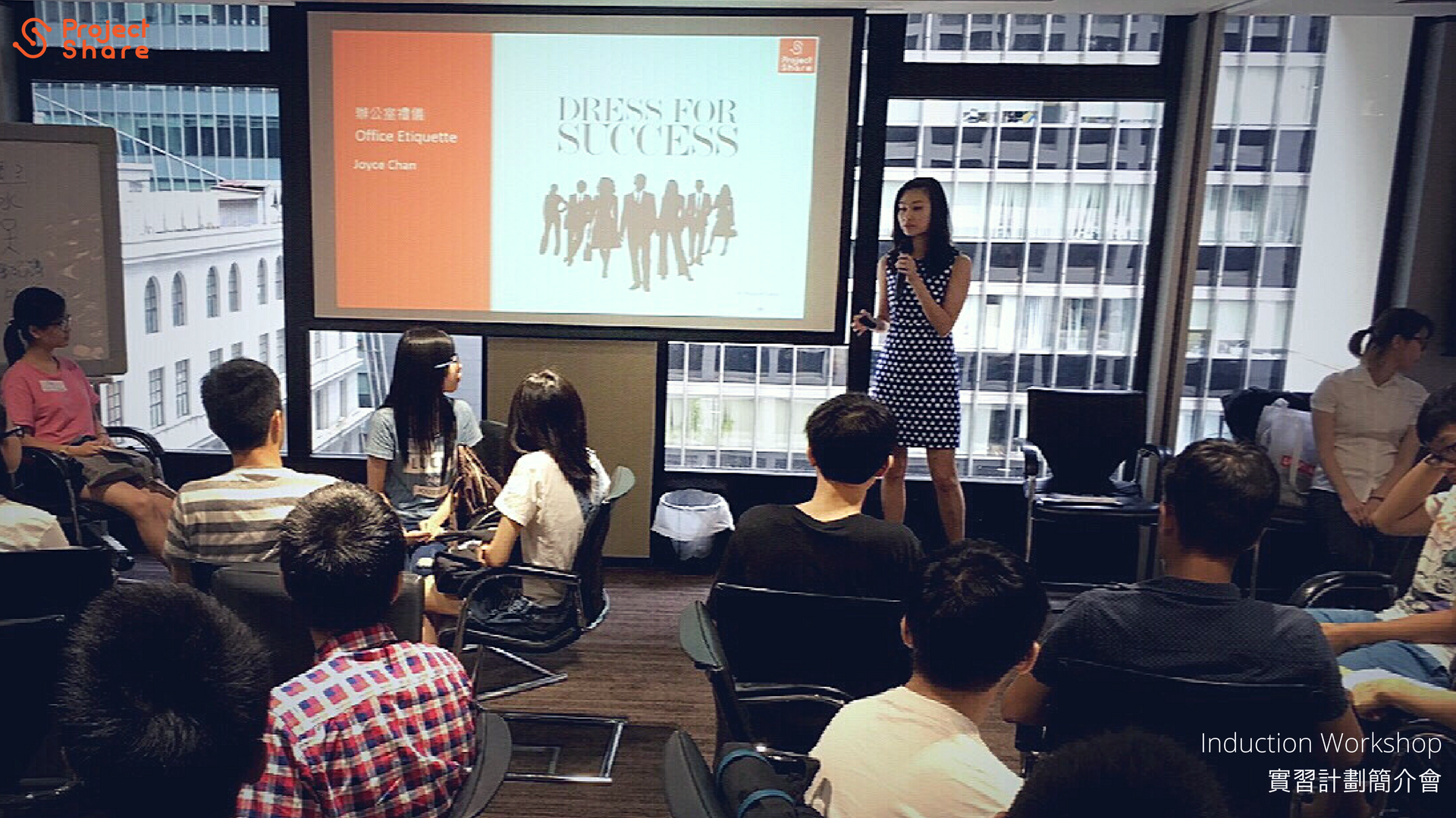 Speaker explains the right dress code for the workplace in induction workshop.