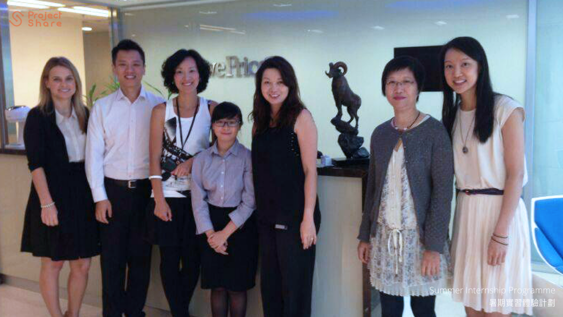 Participants at T. Rowe Price take group photo with mentor and colleagues.