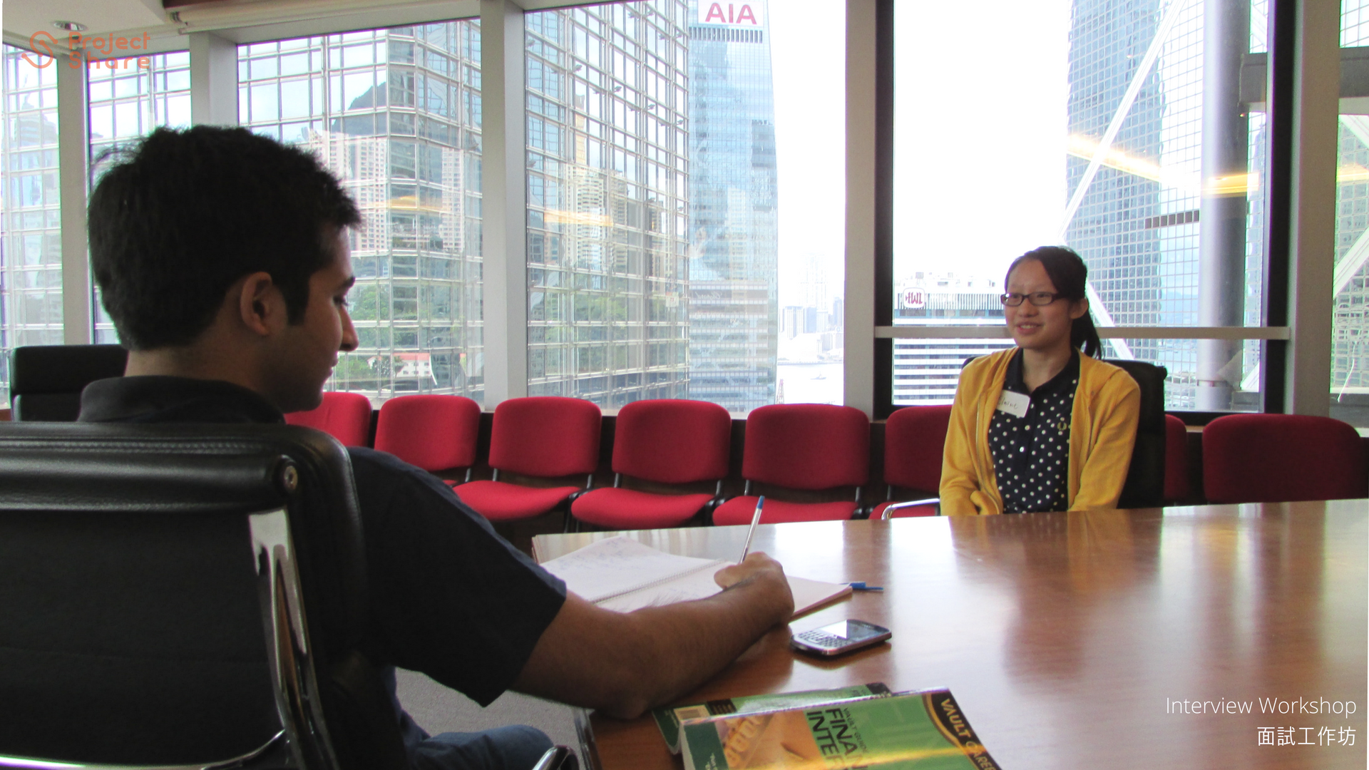 Student doing mock interview with student participant.