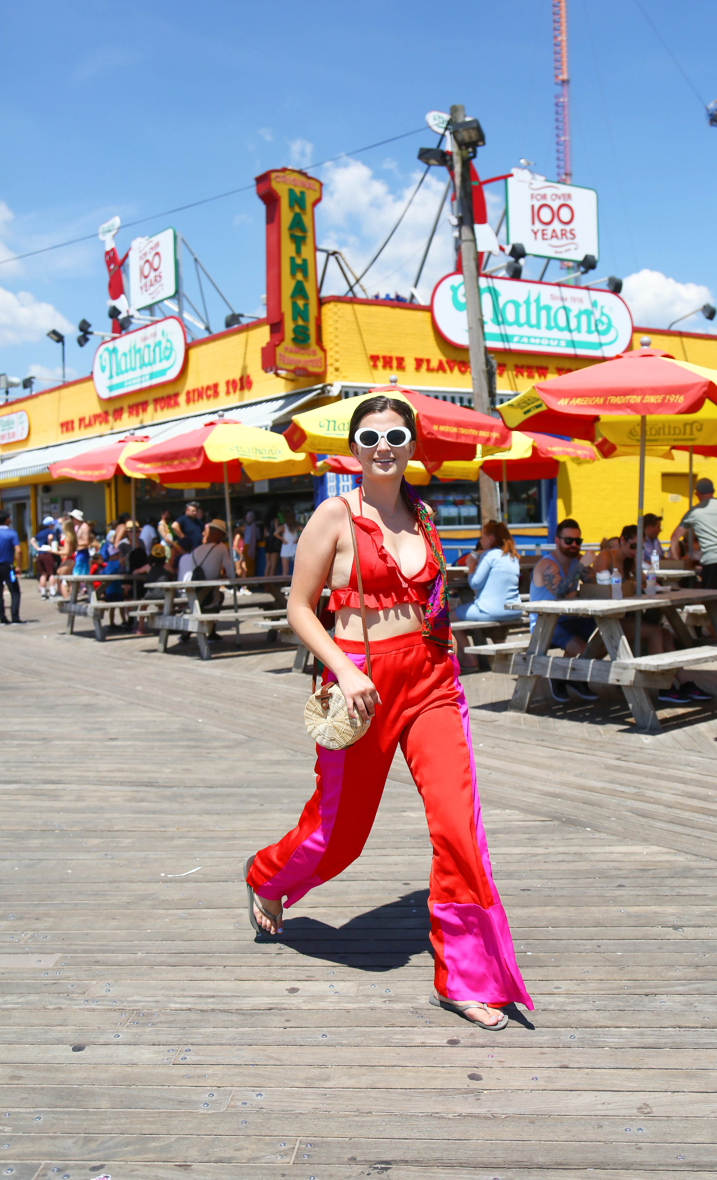 Vintage boardwalk empire - Pairing a ruffled bathing suit top with a pair of satin pants is a great way to bring some glamour to a traditional swim look. Grab your basket bag, a hair scarf, and some oversized frames to complete the look.