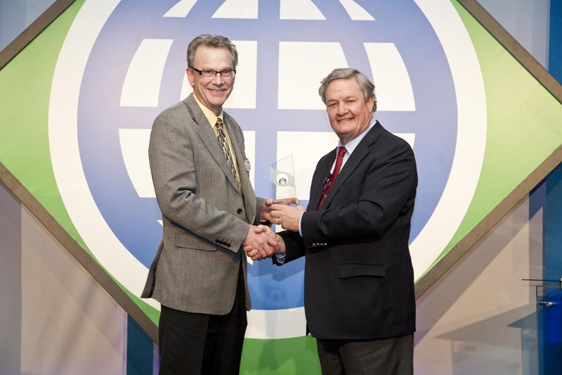 John Crabtree (left), NCI Assistant Director, accepts the Service to Exporters Award from Governor Jack Dalrymple, (right), who presented it on behalf of the North Dakota Trade Office (NDTO).