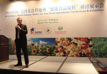 """John Crabtree, NCI Assistant Director, spoke to the conference audience in Beijing about the services that Northern Crops Institute and the region can provide to the China food industry. """"NCI hasextensively researched how North Dakota commodities can be used as food ingredients in Chinese cuisine at various levels that add value to the processor and the consumer,"""" said John Crabtree, NCI Assistant Director."""