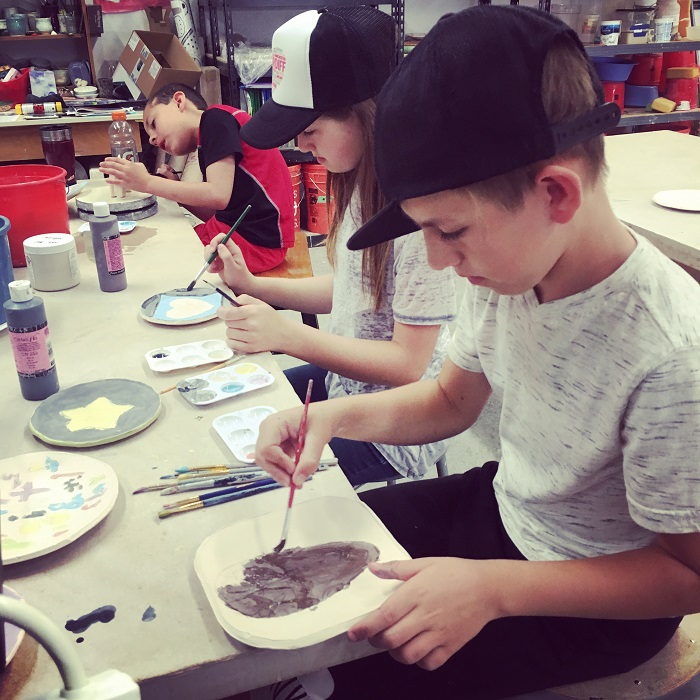 Students glazing their clay pieces. April 2017