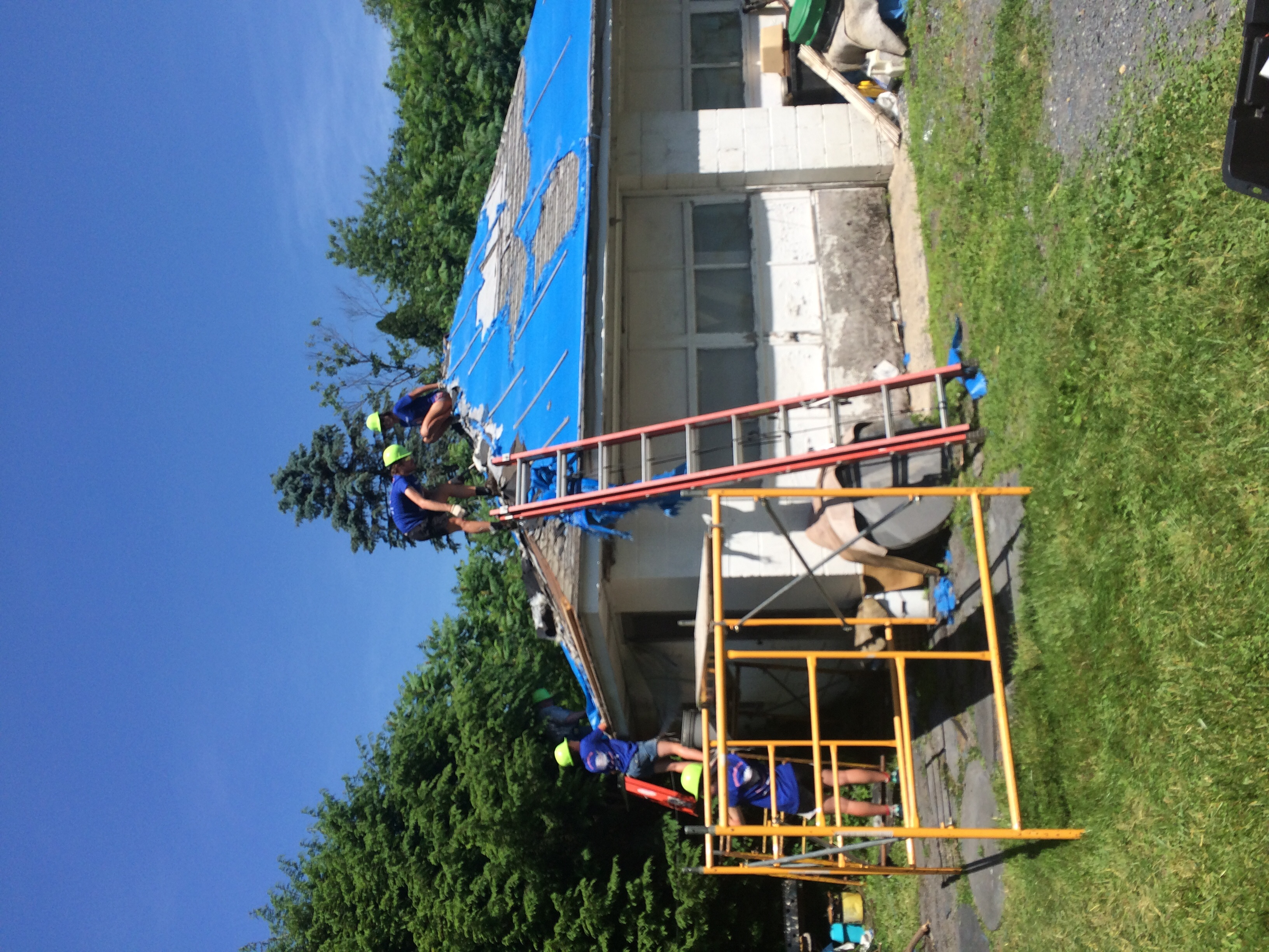 Build day- we removed the old roofing and put up a new one! That's me on the top!