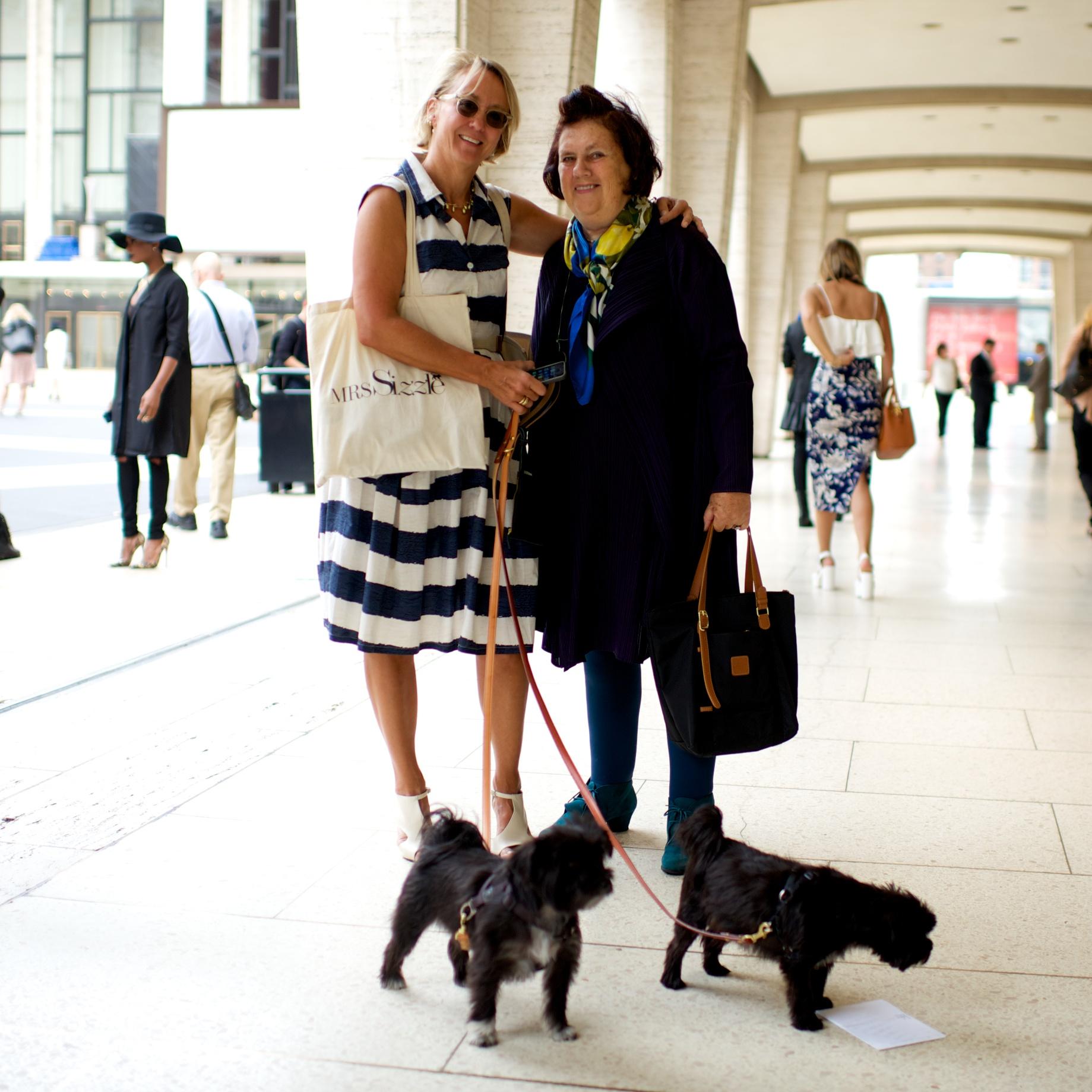 Mrs. Sizzle and Suzy Menkes taking Shinola leashes to the street.