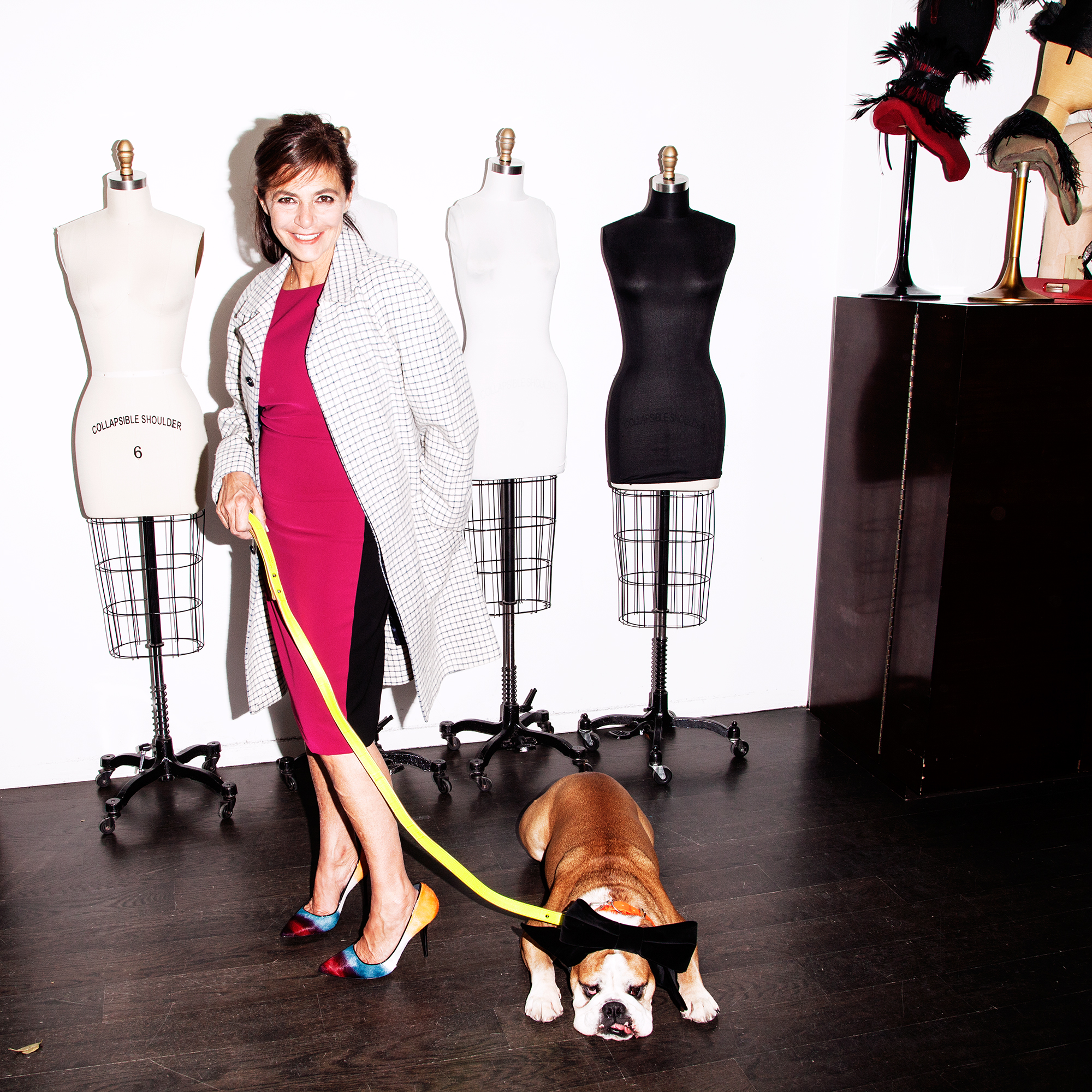 Irene and Gus in the Library. Irene wears a Narcisco Rodriguez dress, a Balenciaga Houndstooth coat and Pierre Hardy pumps. Gus wears a Balenciaga leash.