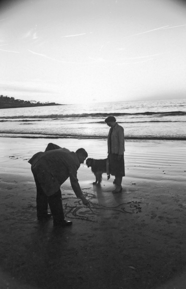 God I love this man and here he is on the beach with his wife Helen and dog Cluny, 1959.