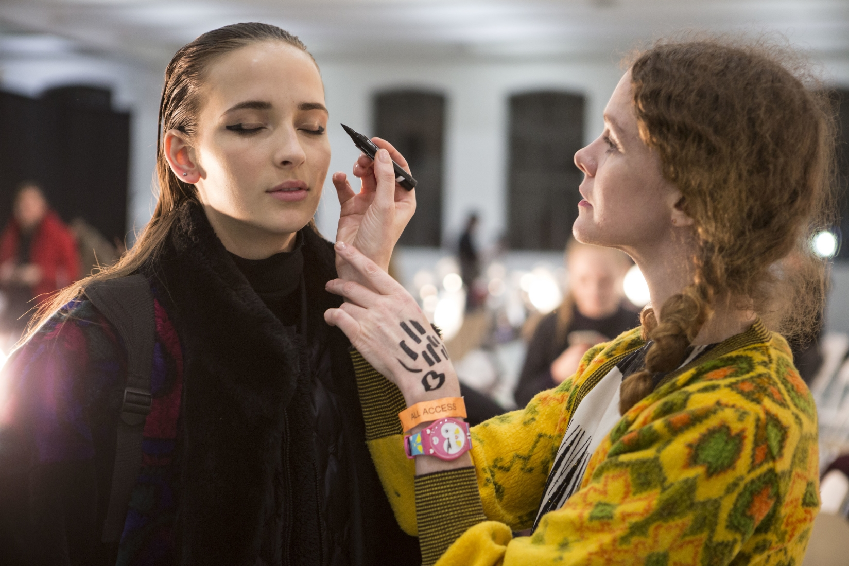 Alice Lane photographed by Mark Leibowitz doing makeup at the Suno show in her Swatch watch as seen in New York Times Style Section