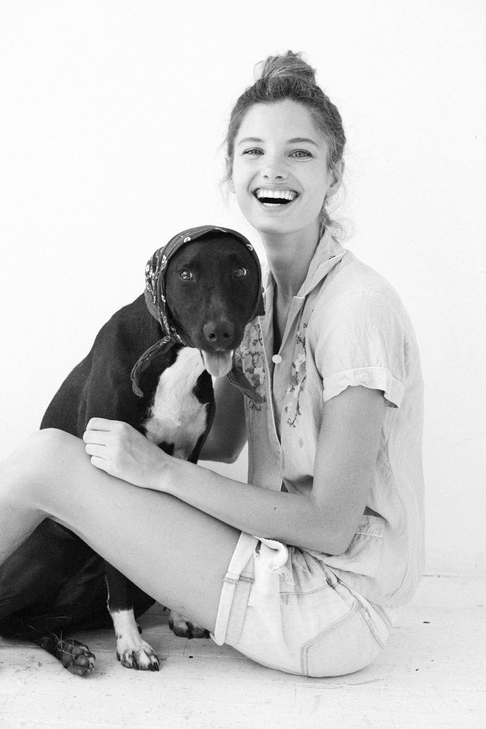 """Ava Smith of Wilhelmina and her foster dog, Lola. """"I've been fostering dogs since 2008 (over 20 dogs!). More recently, I've been traveling to Puerto Rico to bring stray dogs up to NYC, and helping them find homes here on the mainland. I encourage everyone to adopt a Sato (Puerto Rican stray) because they are the BEST dogs"""" Ava works regularly with  @animal_lighthouse"""