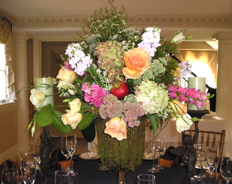 Tall centerpiece with mixed flowers & moss