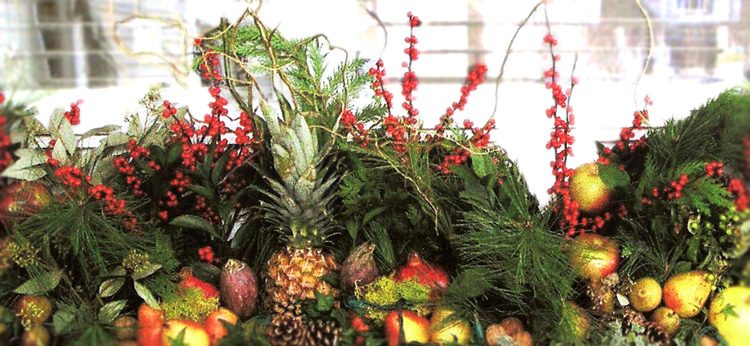 Holiday window box display with fruit, berries & greens