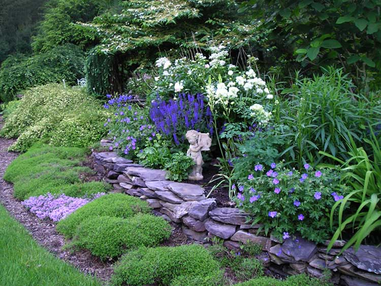 Peaceful rock garden with statuary