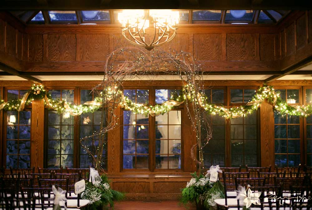 Winter ceremony with grapevine arch at Willowdale Estate : Photo by Zev Fisher
