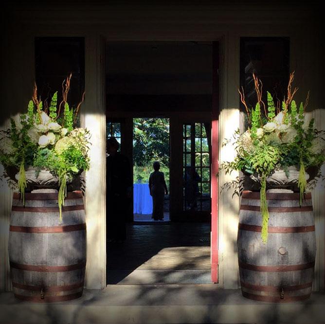 Wine Barrel Floral Display for A Rustic Wedding