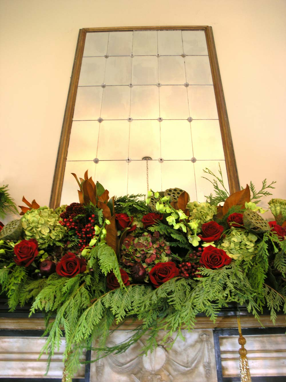 Holiday Mantel with roses & gold tassels