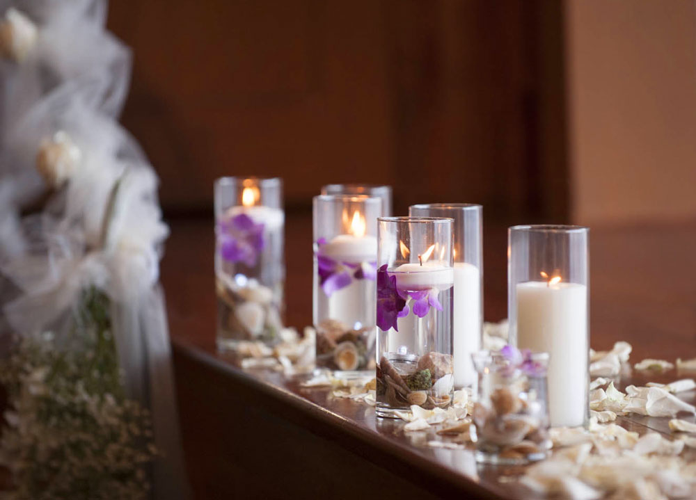 Submerged orchids in glass vases for a Wedding Ceremony