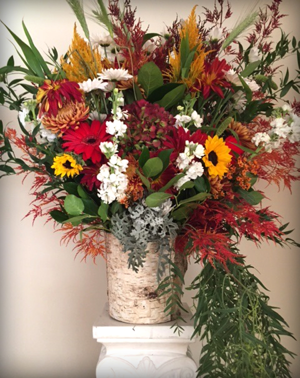 Fall centerpiece with sunflowers Hellenic center