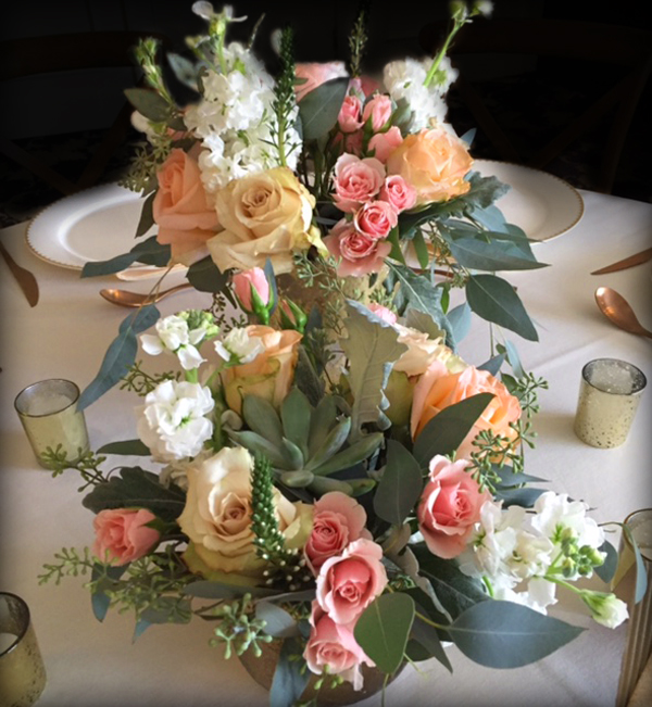 Centerpieces with succulents, The Essex Room