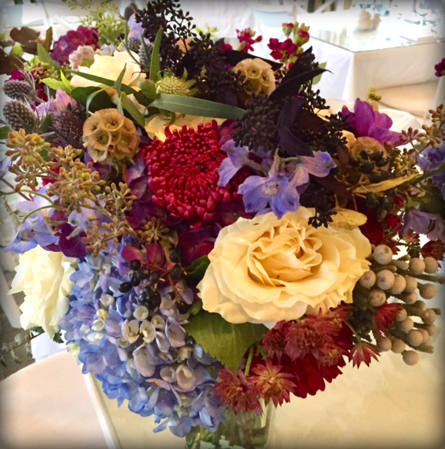 Bouquet with berries, foliage & mixed greens