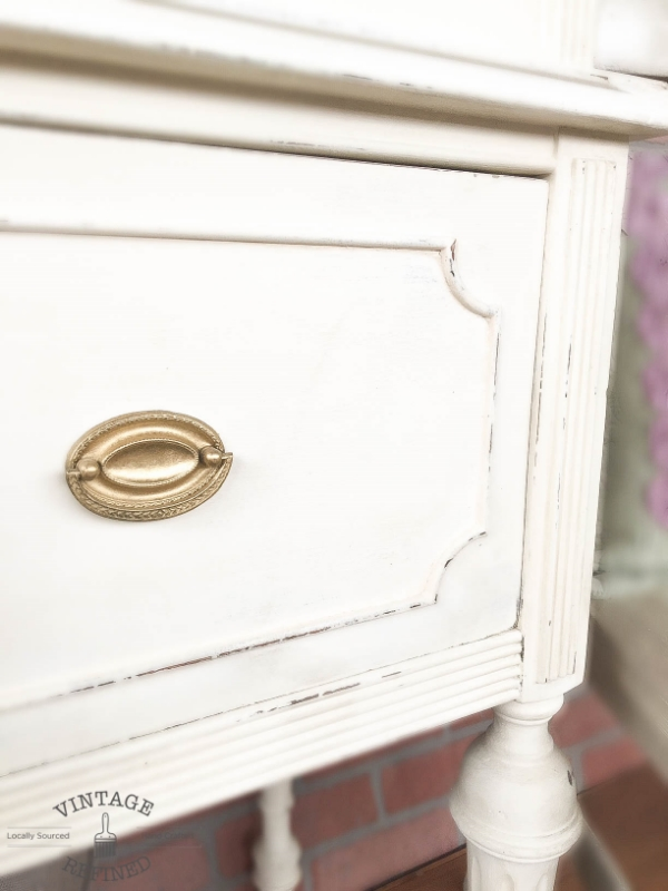 white bookshelf with gold hardware