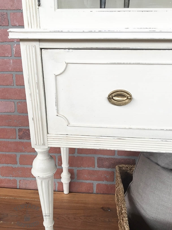 white cabinet with gold hardware