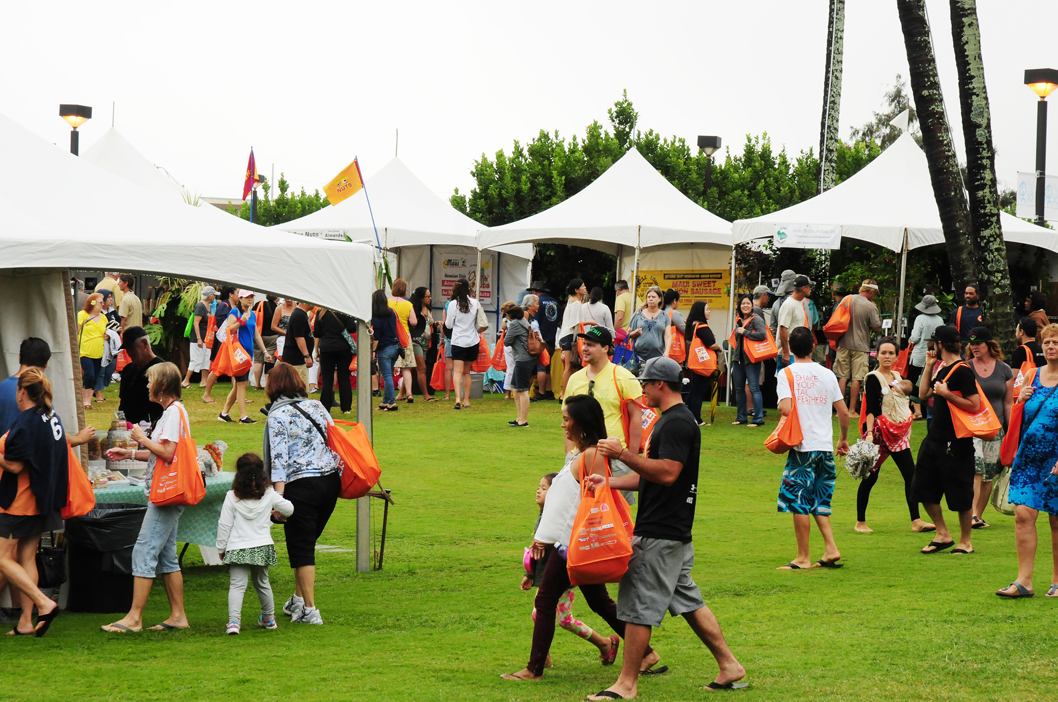 Despite a steady downpour of rain, the inaugural Made in Maui County Festival in 2014 still managed to attract over 9,400 residents and visitors for a full day of shopping.