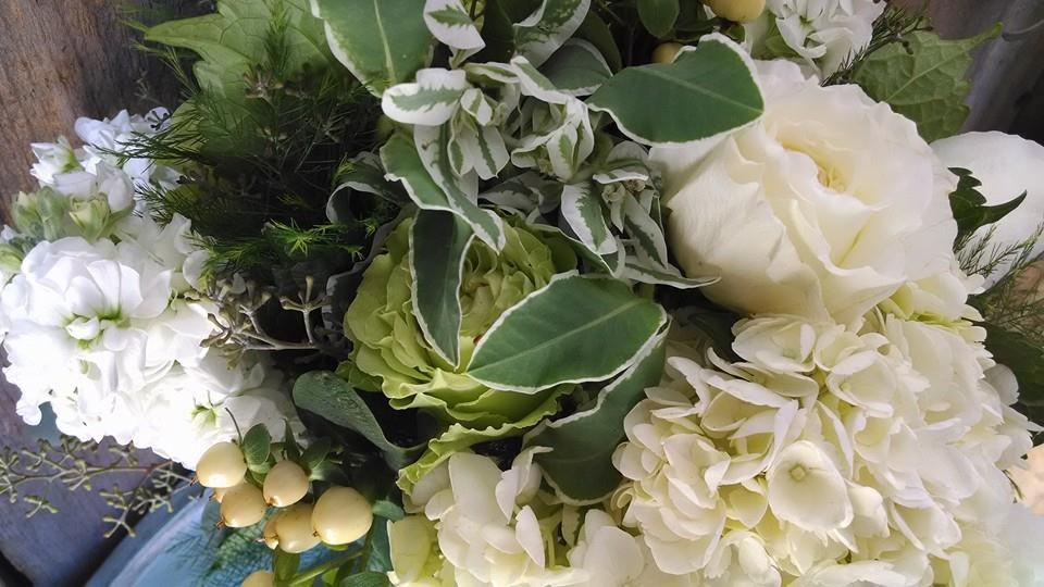 White hydrangea and stock with white green roses and white hypericum made this one big and beautiful.