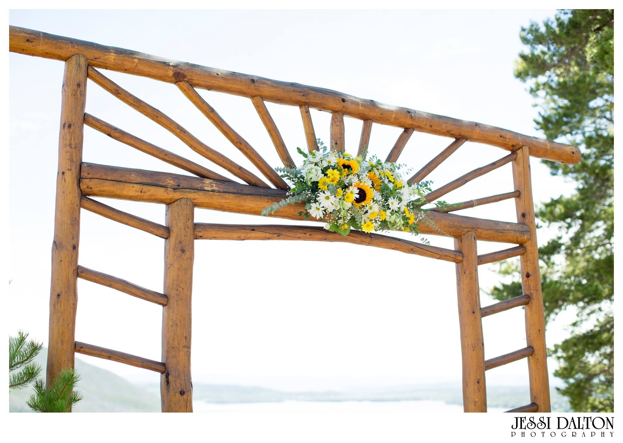 Arch design at Grand Lake Lodge to go with the sunflower theme of the brides bouquet.