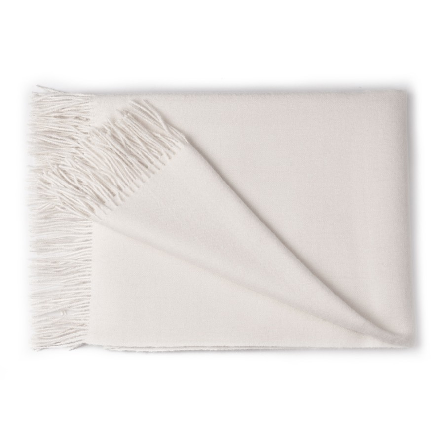 cream -size: 51 in x 71 in (with fringes)