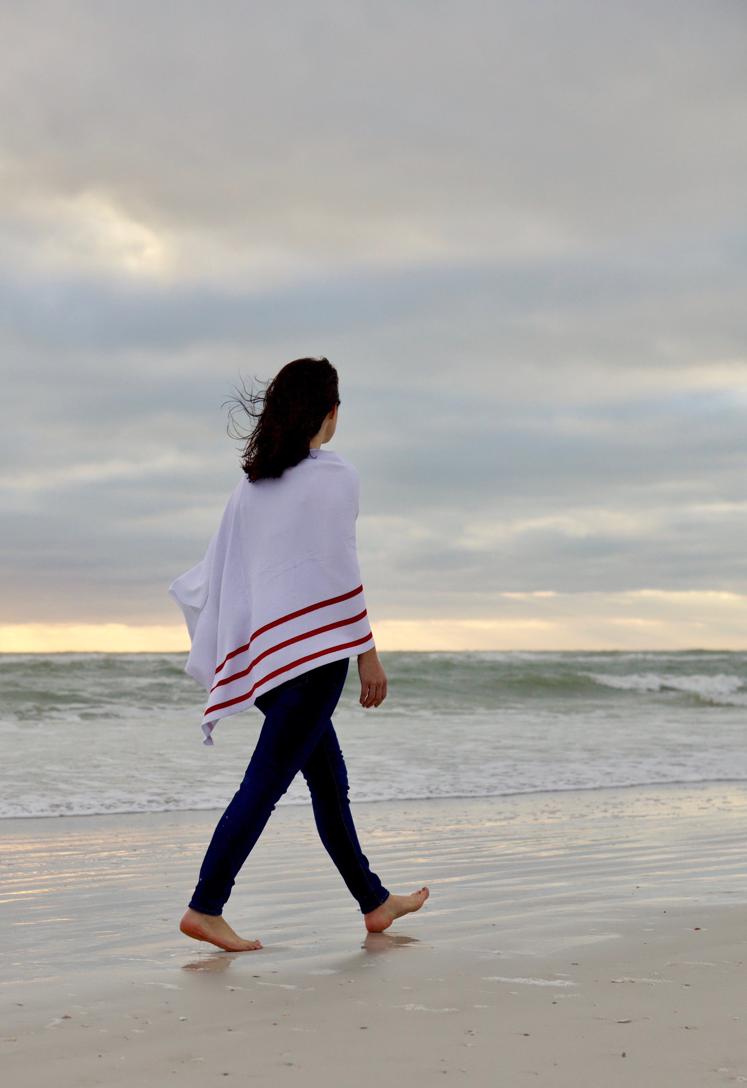 cANNES PONCHO - A stunning poncho with three bold stripes. 35'' W x 27'' L. Available in blue/white, black/white and red/white.