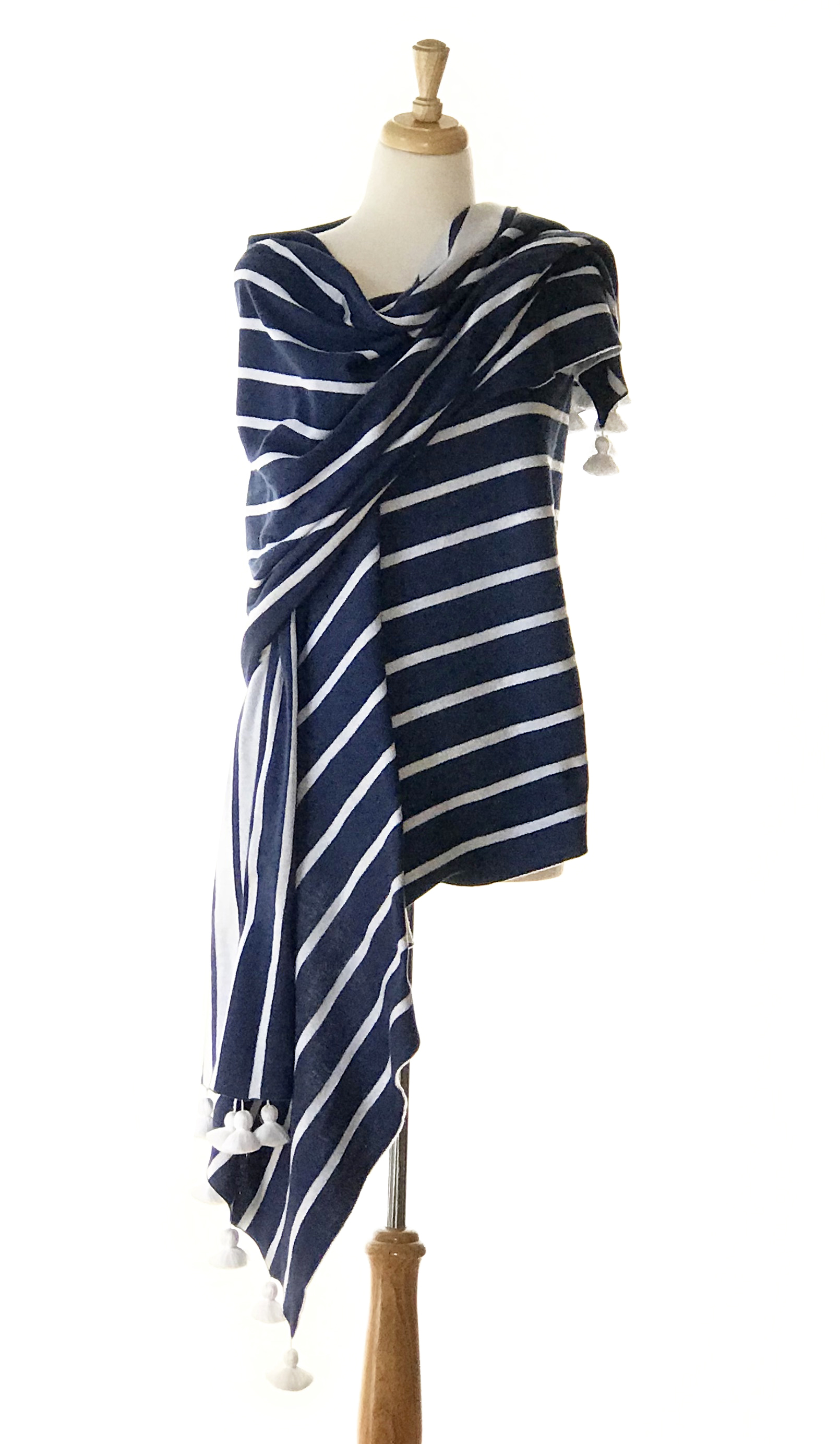 ANTIBES WRAP - Surround yourself in this long and lovely wrap with brilliant stripes and cheerful pom poms. 86 x 27 inches not including pom poms. 100% Peruvian Cotton.