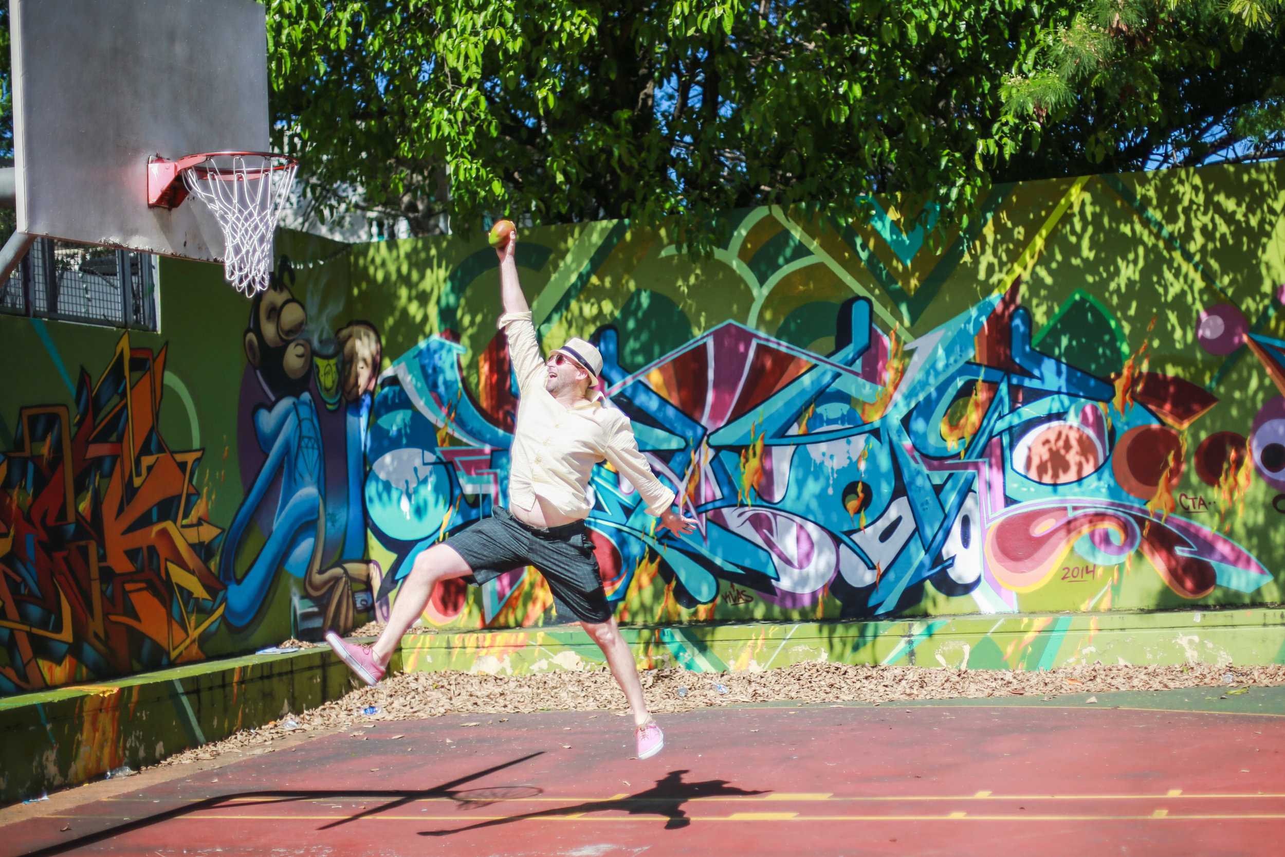 Never a dull moment with this one.... While walking past a local bball court, this old college hoops player couldn't resist attempting to dunk a mango. Key word being attempt. (He was more of a 3point wonder.)