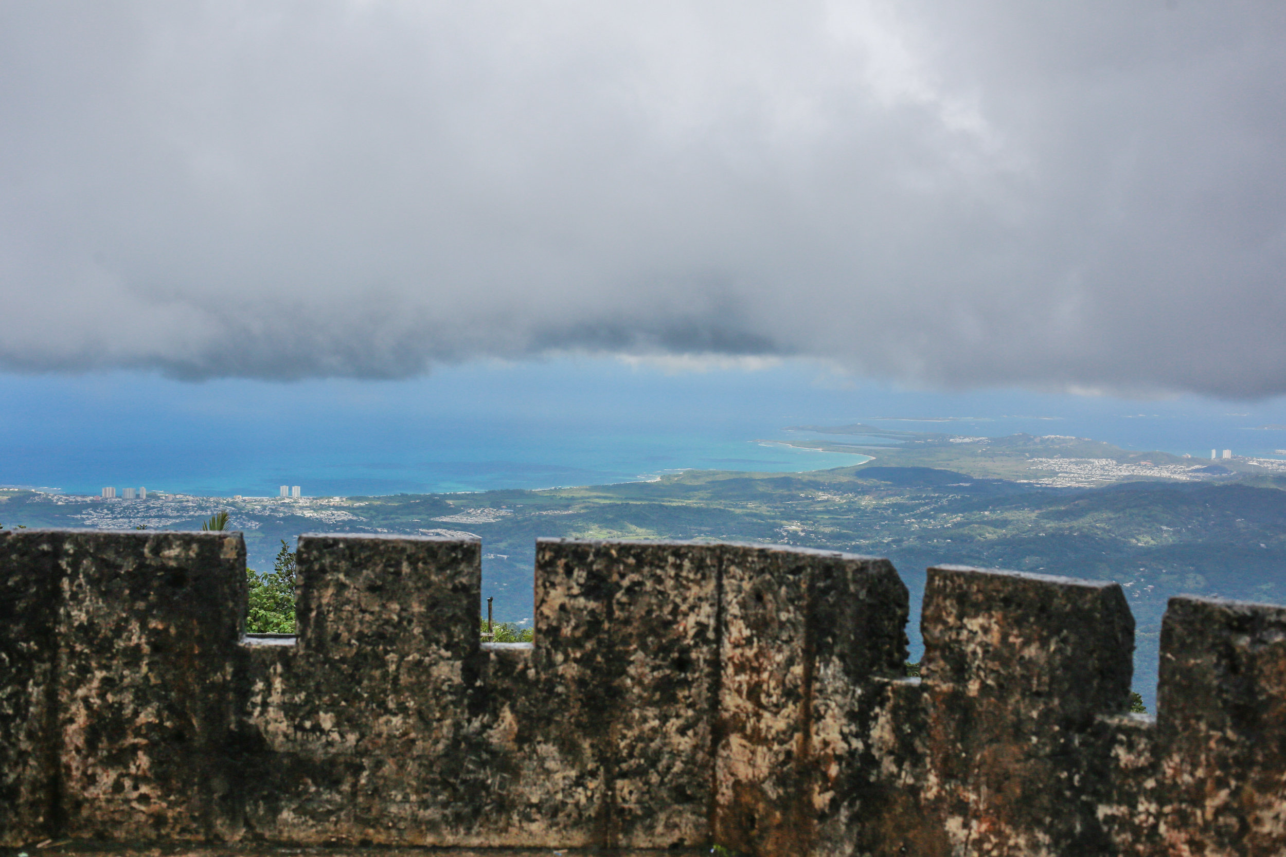 Top of the Old Tower on El Yunque peak, you can see San Juan down on the shores below. Crazy.