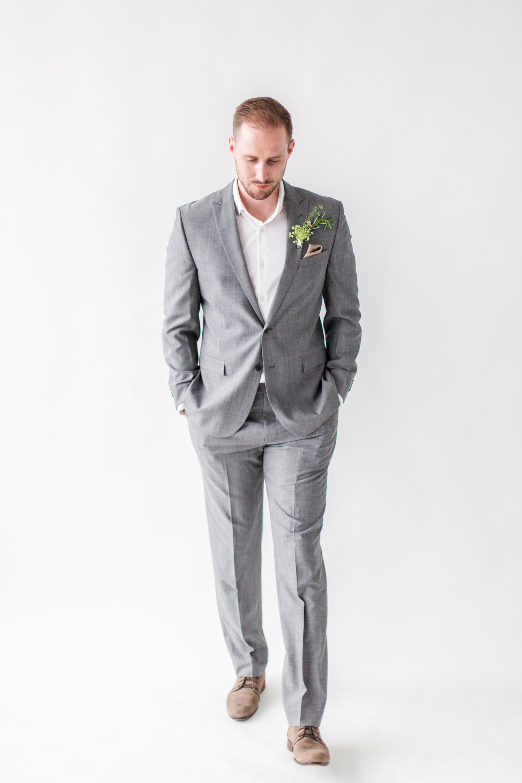 Real groom Daniel wearing a moisture-wicking dress shirt by Mizzen + Main;suit by Joseph Abboud