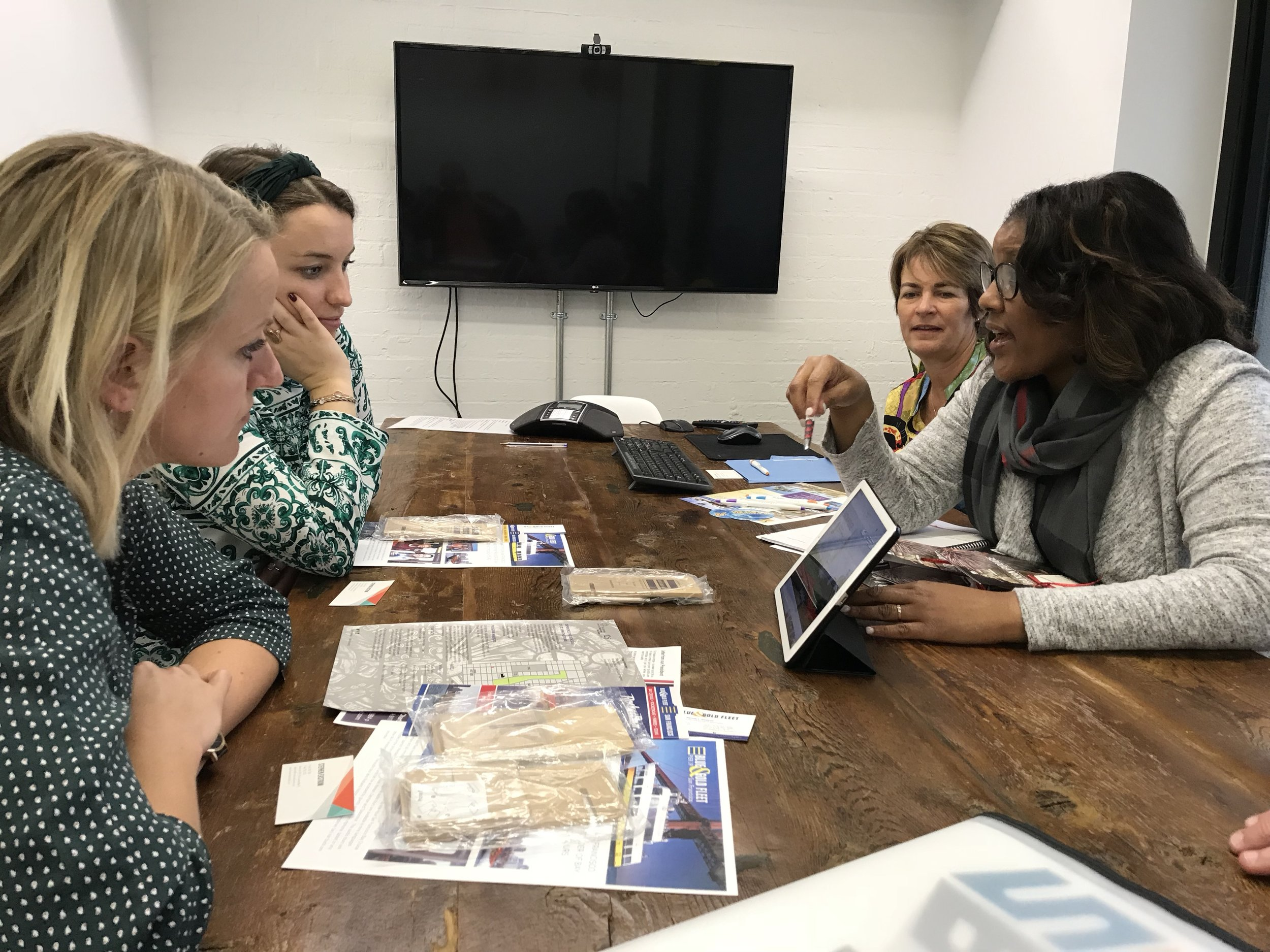 Representatives share destination highlights while meeting with trade buyers on a Fire Starter Brands sales mission to the UK.
