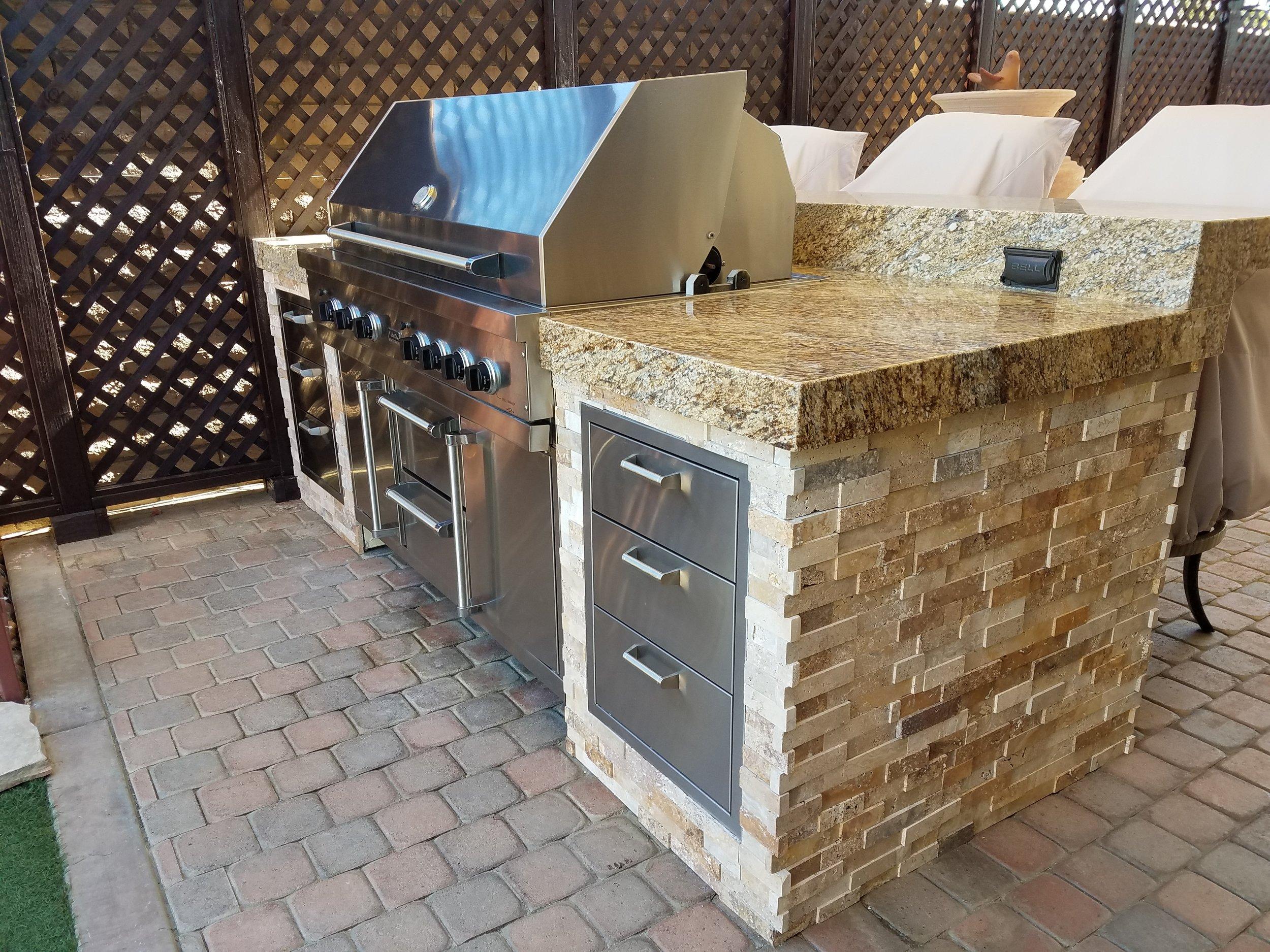 Custom built BBQ island with granite counter
