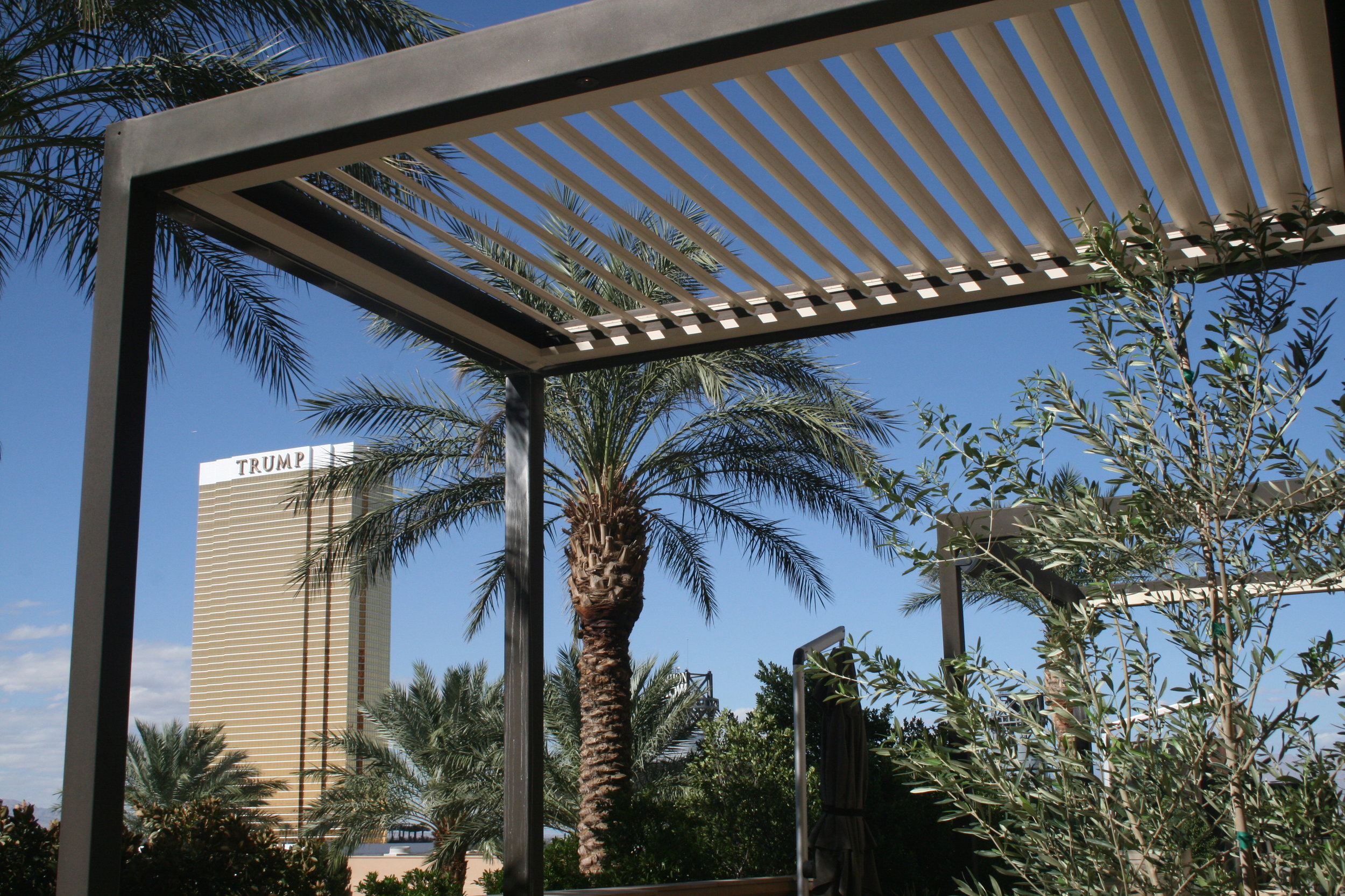 Louvered roof opening patio structure