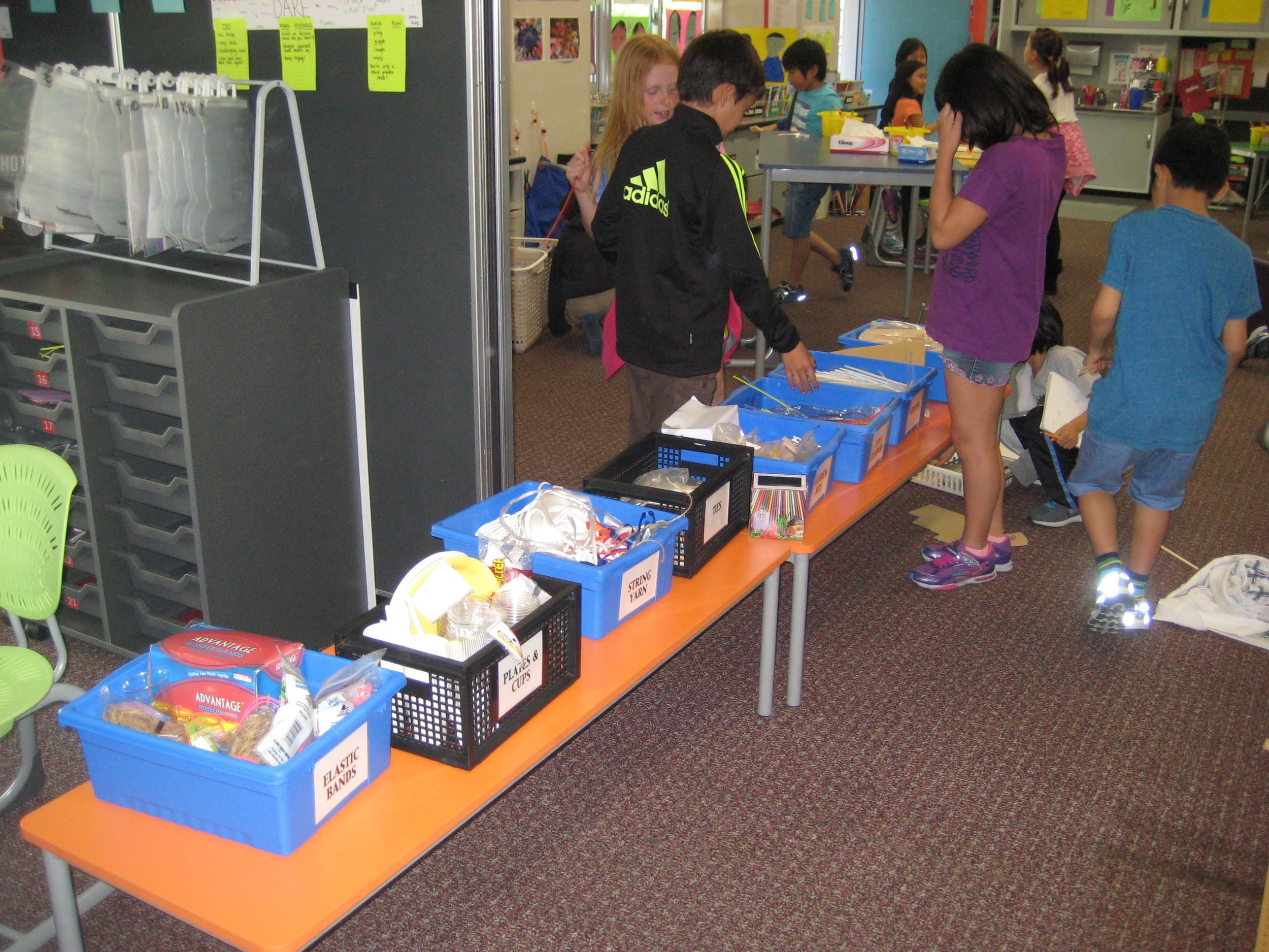 Students look at materials