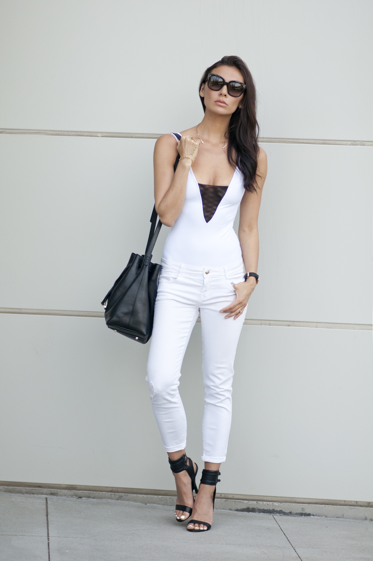 WEARING:  SKYE and Staghorn One Piece , Zara Jeans ( almost identical here ),  Alexis Russell Necklace ,  Daniel Wellington Lady Sheffield Watch ,  Nasty Gal Shoe Cult Desire Heel ,  Wessley Rae Bucket Bag ,  Oia Jules Habanos Hand Piece ,  Céline Audrey Sunglasses