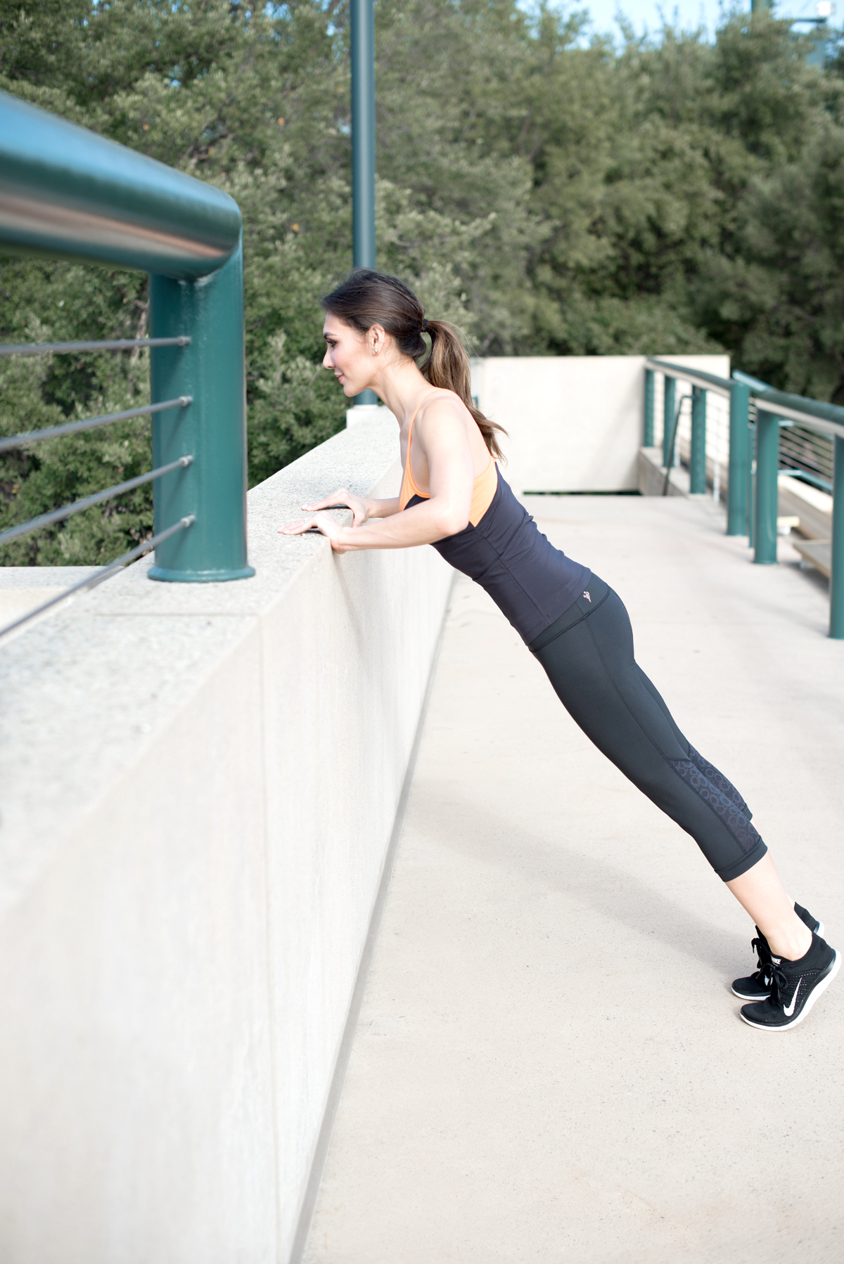 1.  Start with a railing and focus on getting your form down. Hips should be tucked under, abs pulled in, wrists should be under your shoulders, and your elbows should point slightly back. Try to engage your quads for perfect posture and for extra full body strengthening.