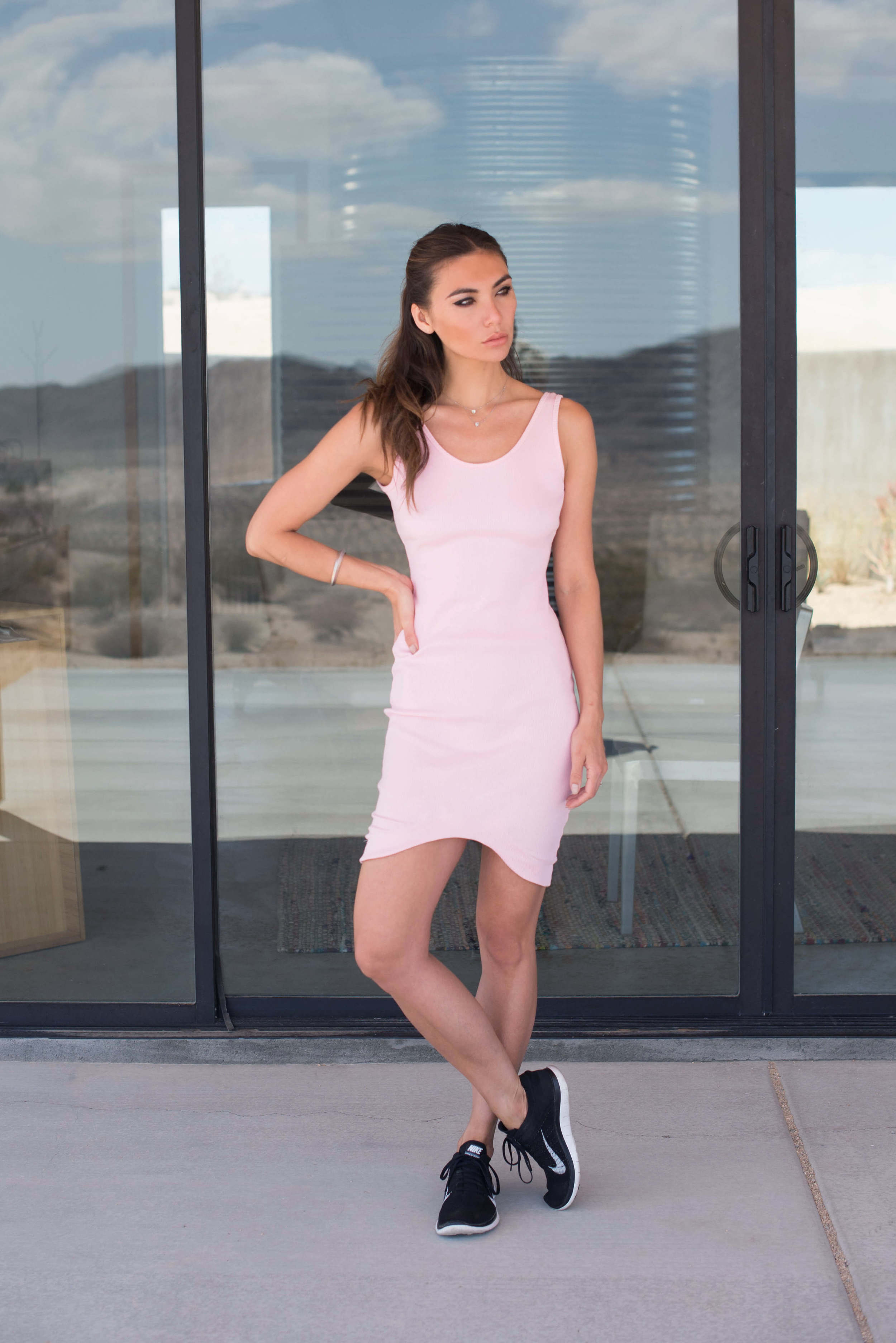 Pink bodycon dress and Nike Flyknit sneakers